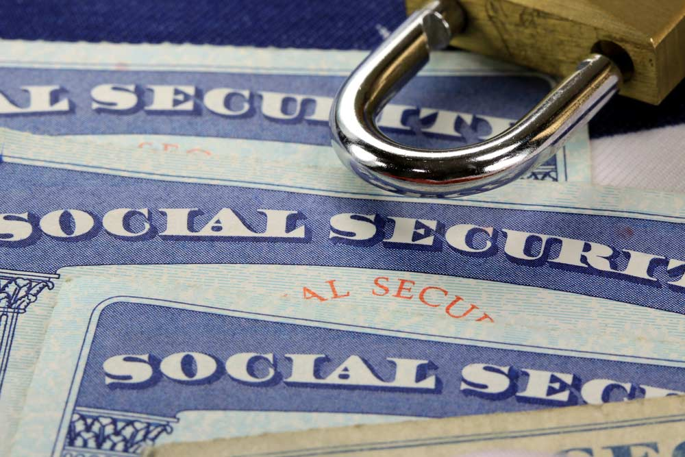 Lock sitting on top of social security cards