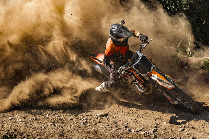 Motorcycle speeding through dirt