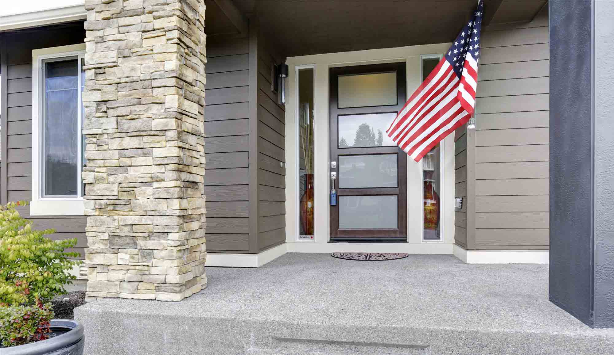 Front porch of a house with an American flag