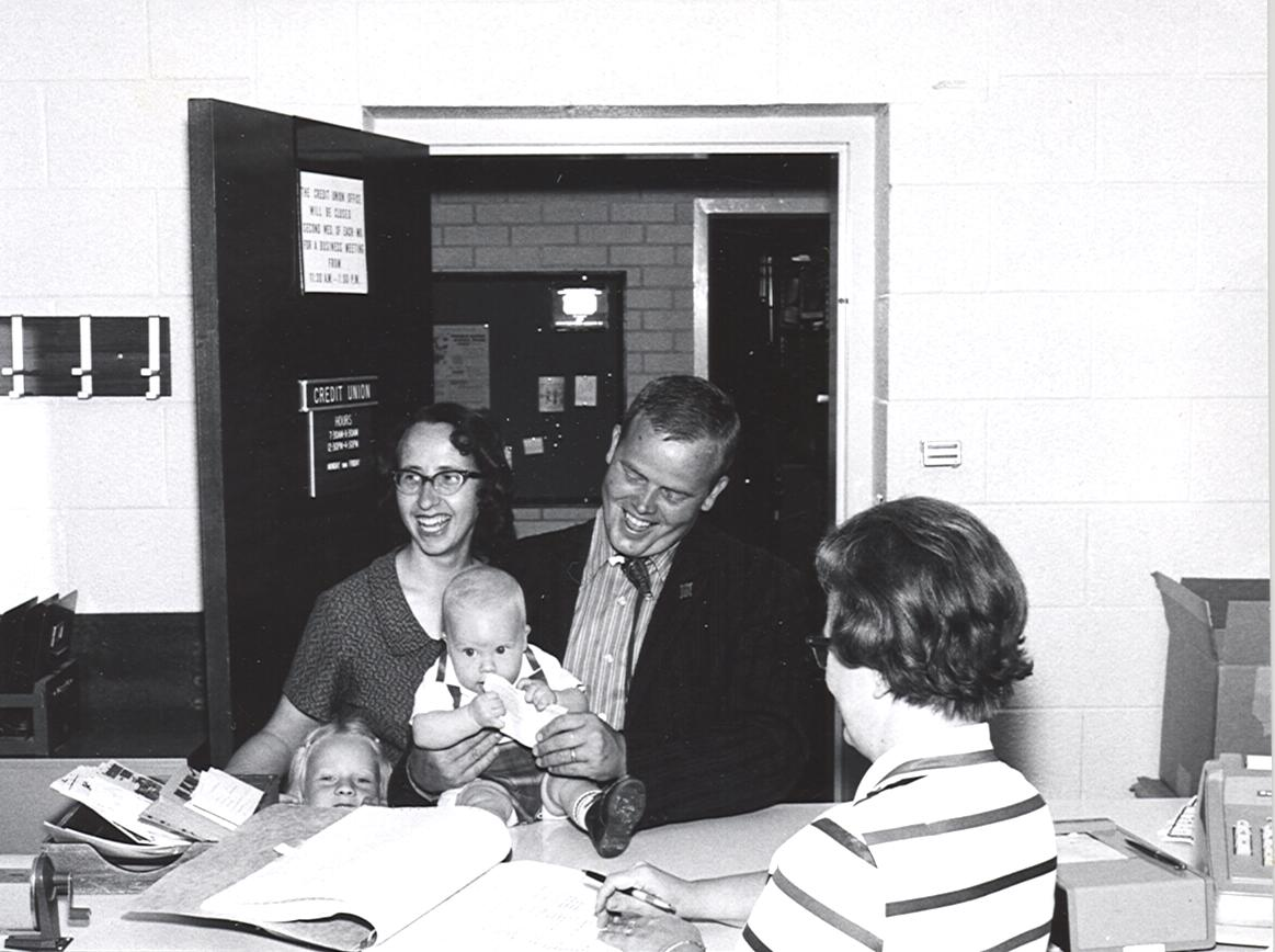 Old photo of a young family visiting the credit union