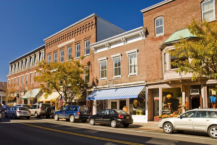 Tidy storefronts on a cheery Midwest main street. Interested in a loan for your business? Learn more about Wasatch Peaks Credit Union secured business loans.