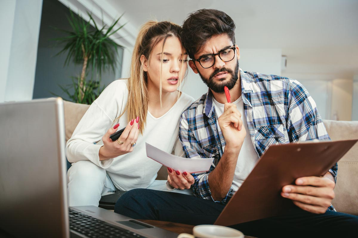 couple looking confused at a document