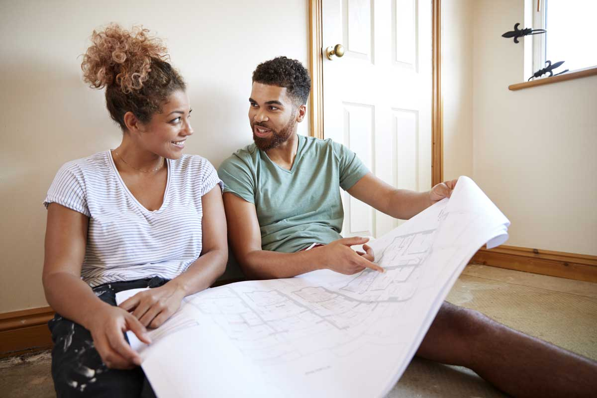 Couple talking about house plans