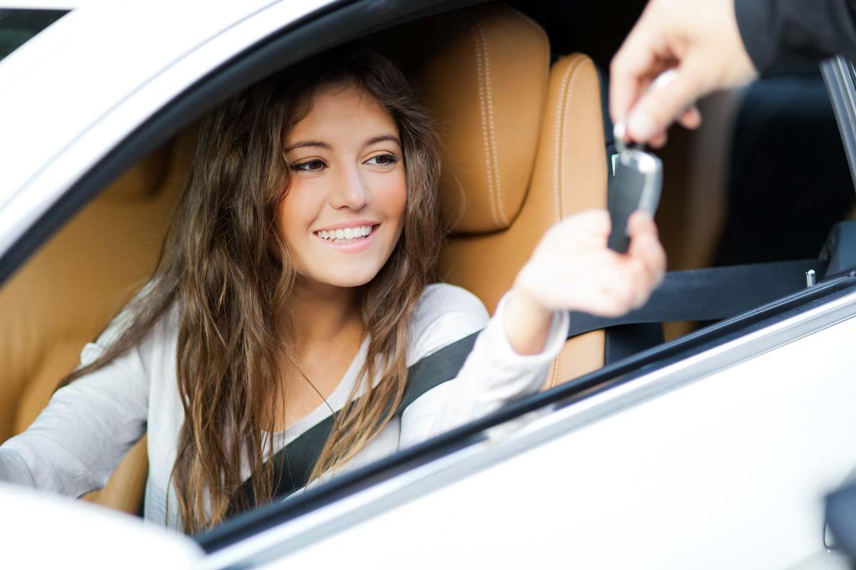 Young woman getting car keys