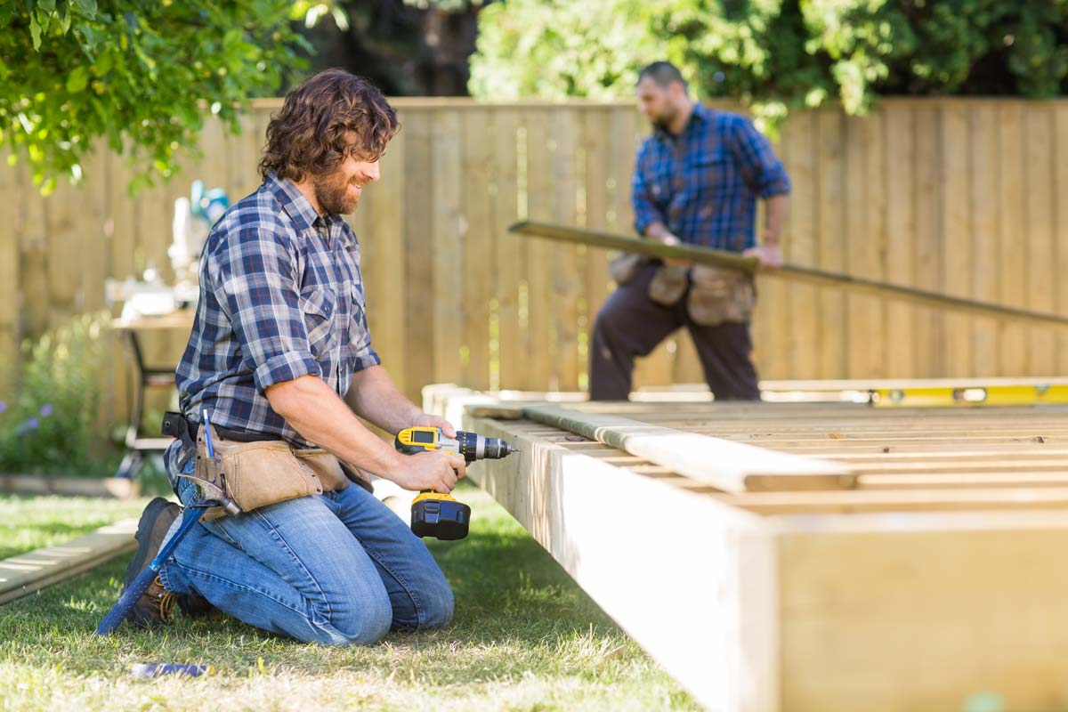 Two men building a wooden structure