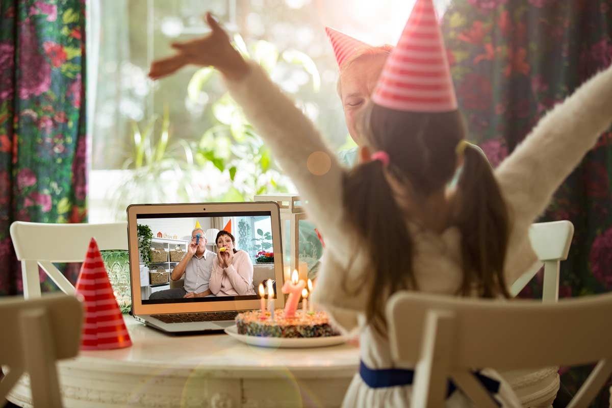 Little girl celebrating birthday with grandparents on video chat