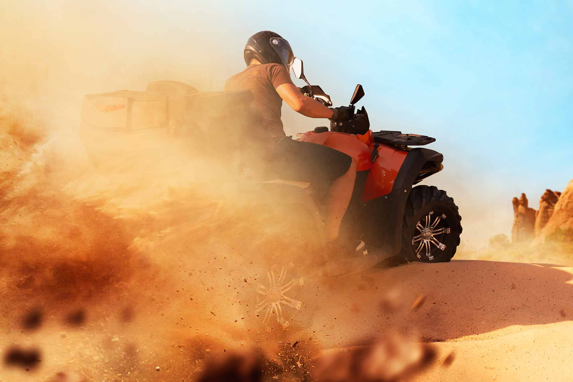 atv-riding-in-sand-quarry-dust-clouds-quad-bike-HKBLRZY