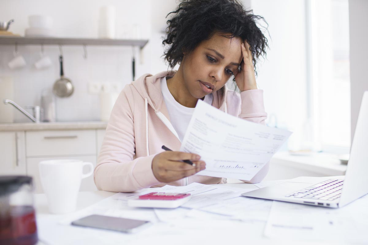 woman looking confused at a paper