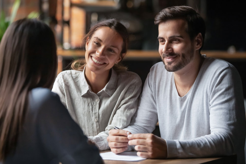 couple meeting with loan officer