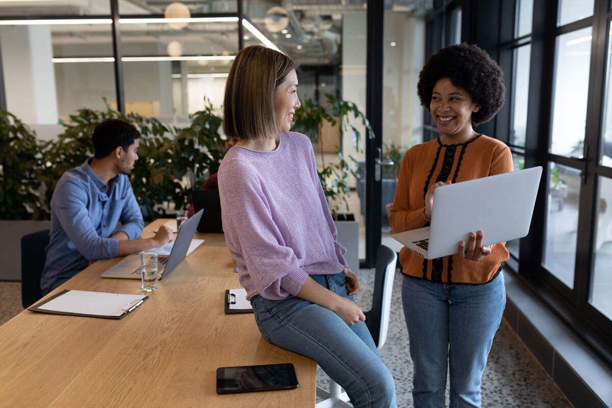 Coworkers discuss how to get a business line of credit to expand their business