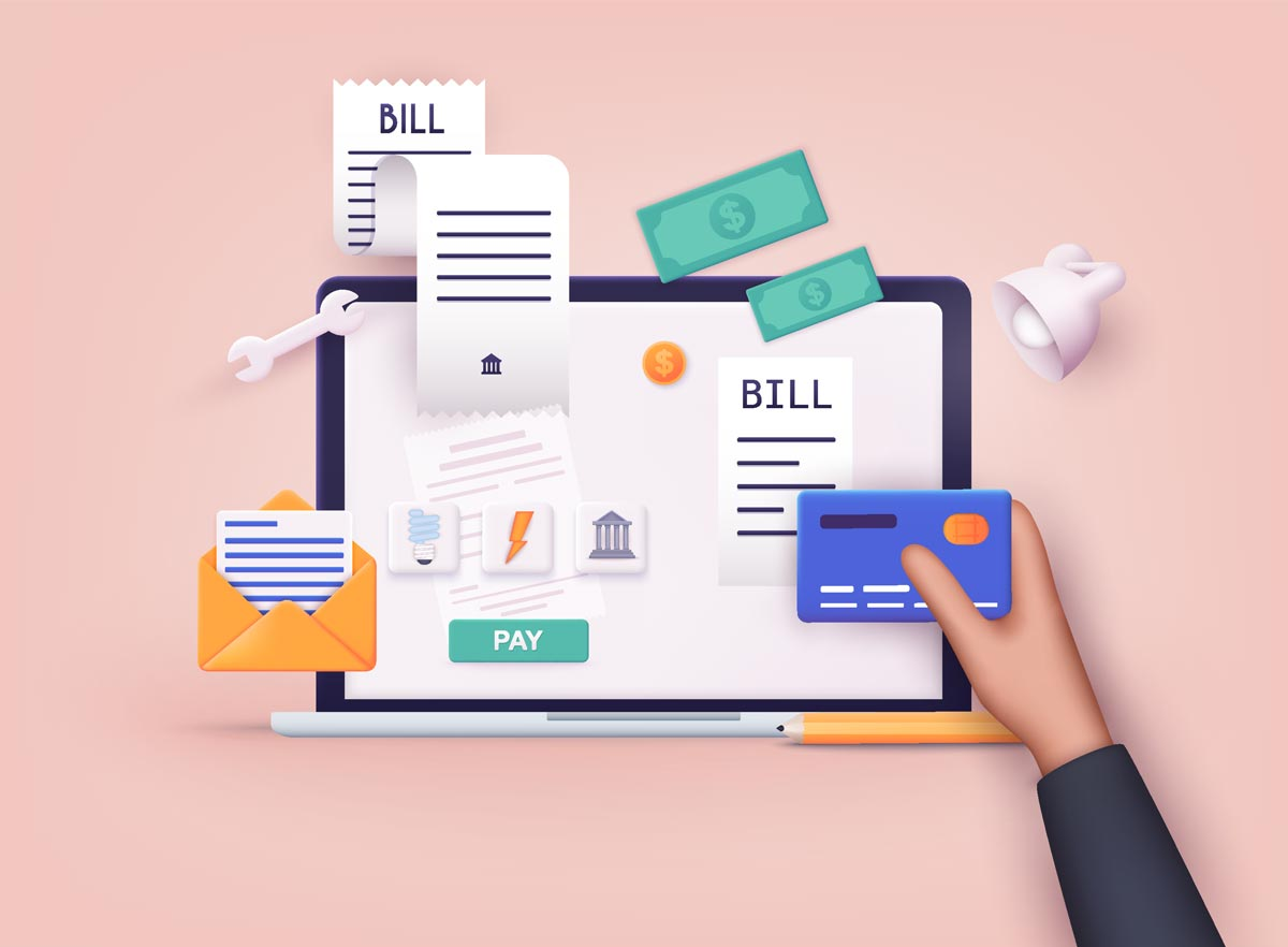 laptop with bills dollars and credit card